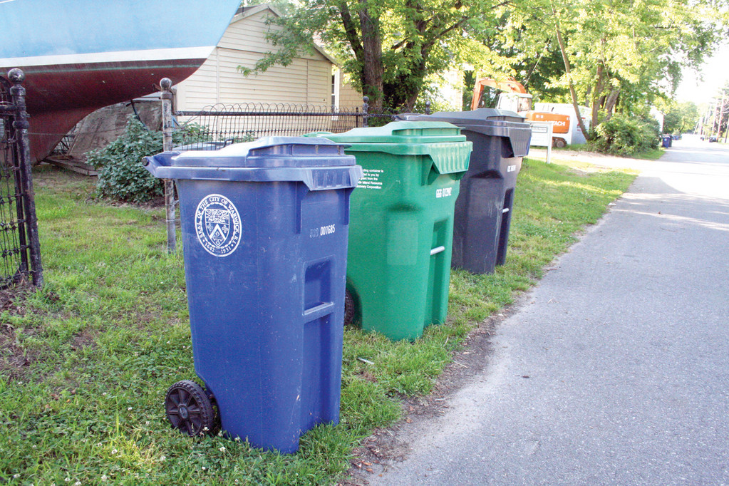 ONE TOO MANY: The city wants residents to mix recyclables and place a cart every week at curbside if they want their trash collected. What they are also asking is that only one recyclable cart – it makes no difference whether green or blue – is used at a time.