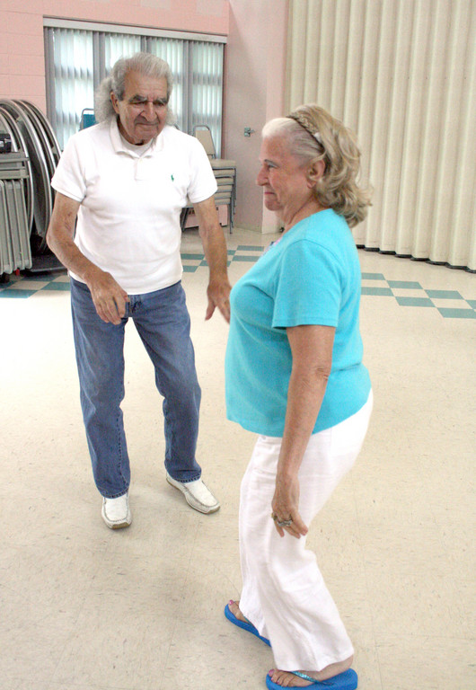 CUTTING A RUG: Ralph and Joan Harris are never bashful when it comes to enjoying the music.