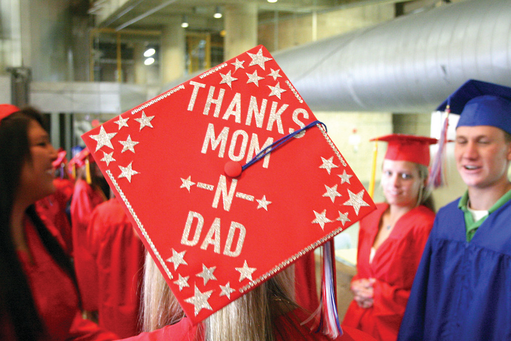 THEY HELPED: Graduate Miranda Coleman displayed her appreciation to her parents. She said, without their assistance she would not have been able to spend most of her senior year taking courses at CCRI. She plans to attend the University of New Hampshire, where she is entered in a pre-med program.