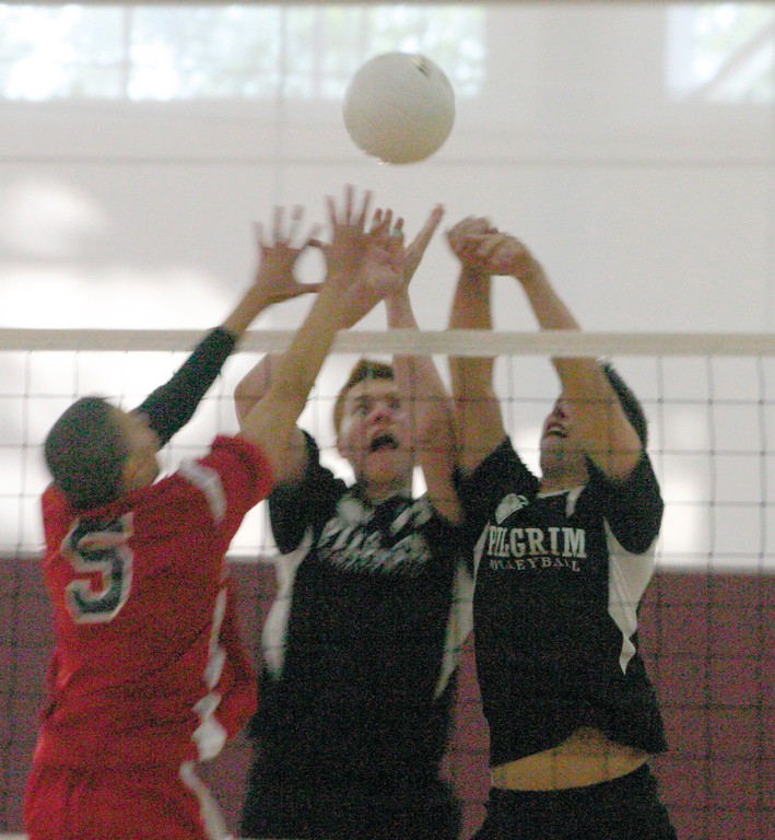 BATTLE AT THE NET: Pilgrim's Dan Colabella and Sean St. Jacques go up for the ball in Monday's semifinal match against Tolman. The Pats won 3-0 to clinch a spot in the finals.
