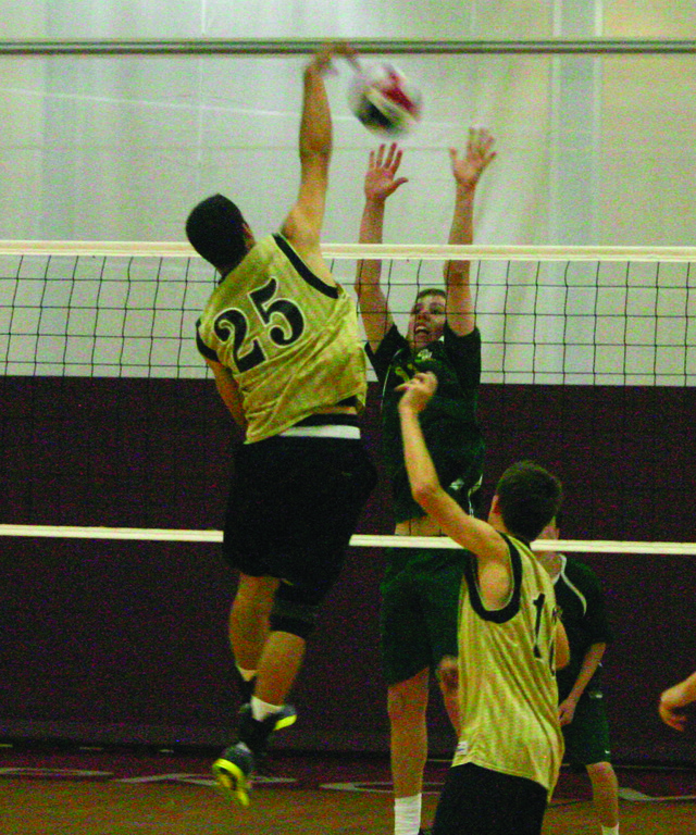 RISING: John Kane makes a block.