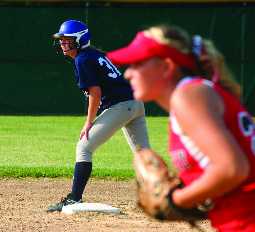 AT THE READY: Courtney Conklin waits to take her lead at second base.