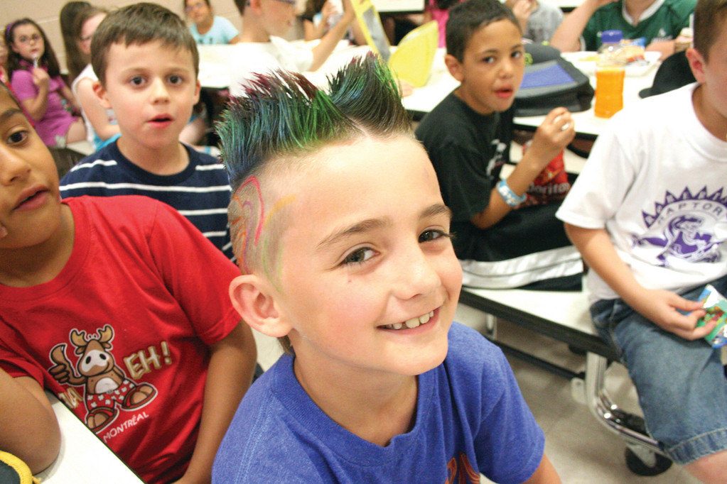 With a double mohawk, the creation of his mother, is second grader Charles Kebarian.