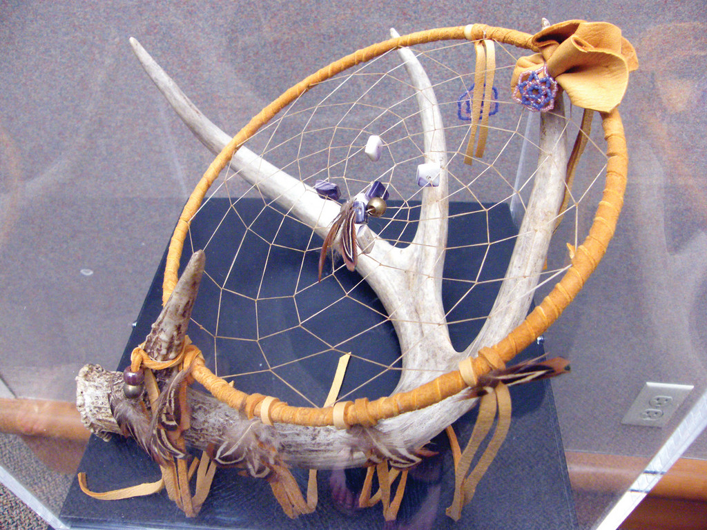 SWEET DREAMS: A dream catcher, a traditional Native American object, is used to filter out bad dreams and allow only the passage of good dreams. This dream catcher, made inside of an antler, was handcrafted by Loren Spears.