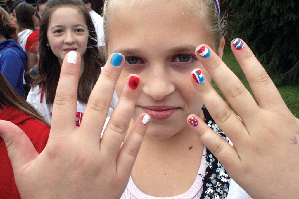 A RED WHITE AND BLUE DAY: Angela Black dressed up for the occasion, right down to her nails.