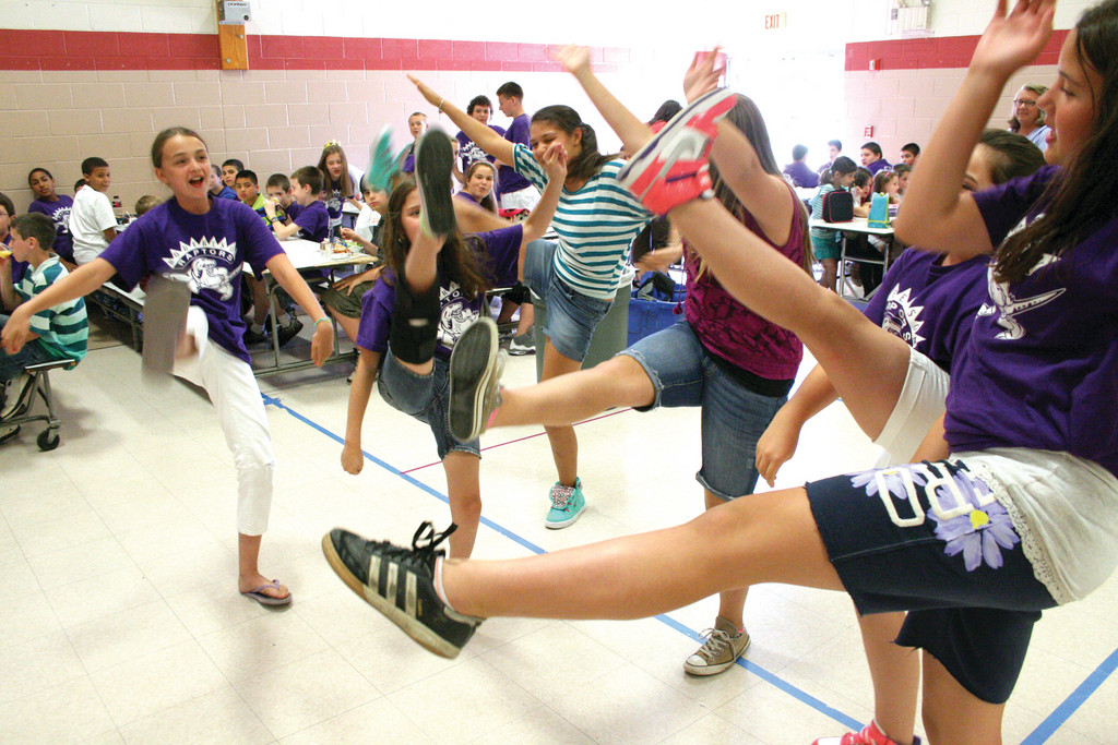KICKING UP: Robertson School sixth graders give the school cheer as they kick off the summer vacation.