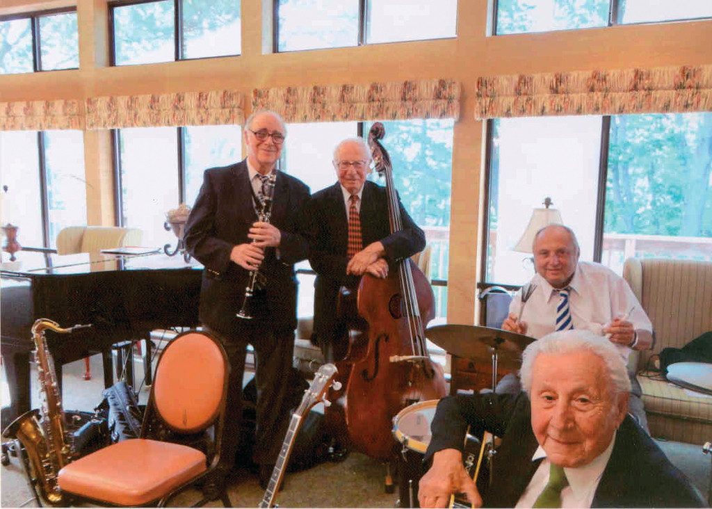 THE ARISTOCATS: Lloyd Kaplan, at left, stands with band-mate Bob Petteruti. Seated at the drums is Joseph Holtzman. In the foreground is Mat Piccirilli, who rounds out the quartet that is The Aristocats.