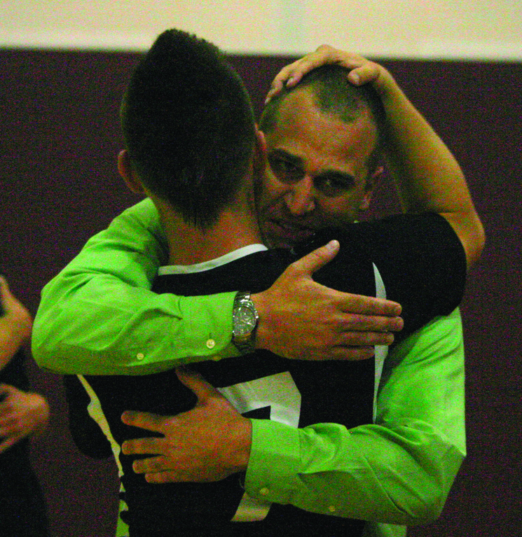 BIG MOMENTS: Sean St. Jacques and coach Mike McGiveron hug after the match.