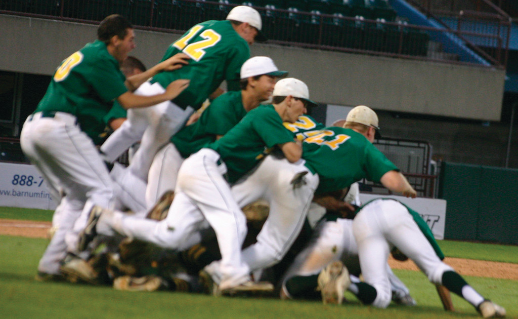 PILE ON: Hendricken players celebrate after the final out in game two of the state championship series on Thursday. The Hawks swept South Kingstown, winning 12-2 and 5-0, to clinch their fourth state championship in five years.