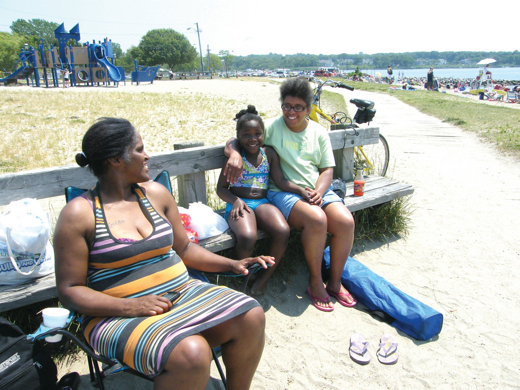 PICNIC IN THE PARK: Kim Williams, at left, decided to take the trip from Providence to Oakland Beach with Maria Lopes and Don'eshia Johnson, age 5. The women said they had packed a lunch and planned to stay for most of the day. Don'eshia had just returned from the water, where her companions, Derrick, Jeffrey and Jordan, played.