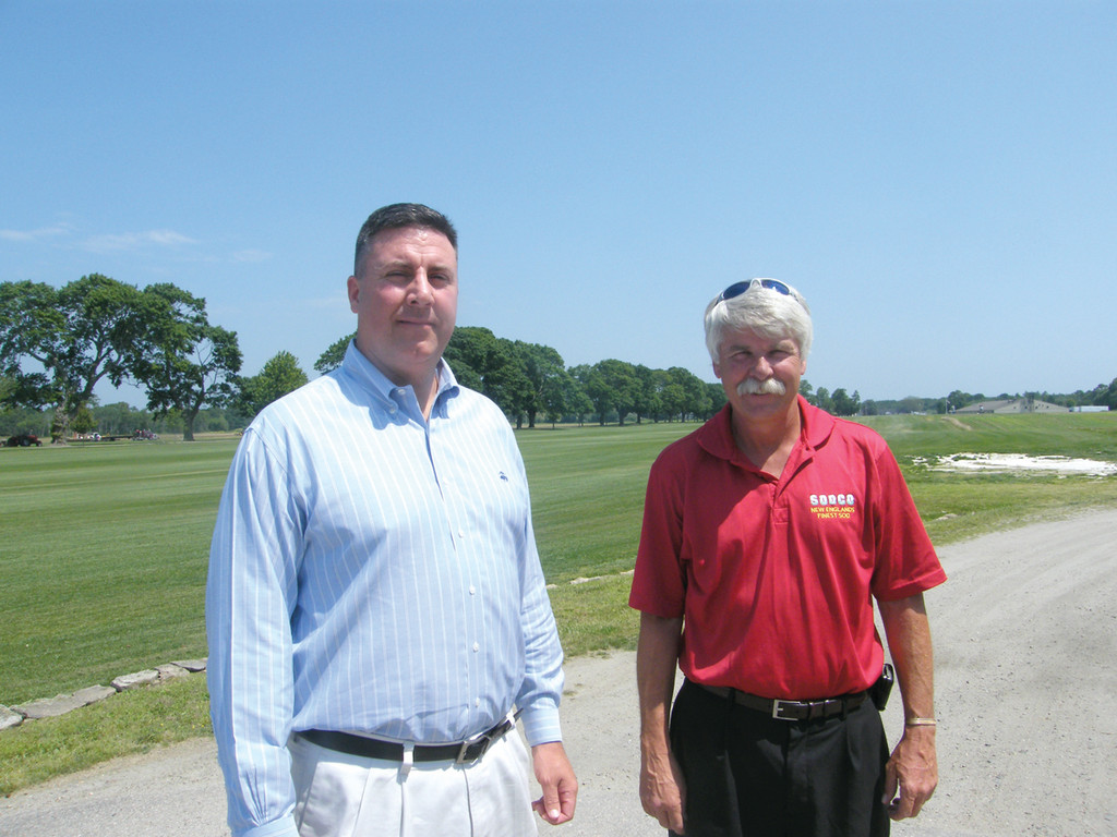 TURF GUYS: Kenneth Burke, left, general manager of the Water Resources Board, stands with Pat Hogan, sales manager at Sodco. Both agree that an inch of water a week is enough to maintain a healthy lawn while being eco-friendly.