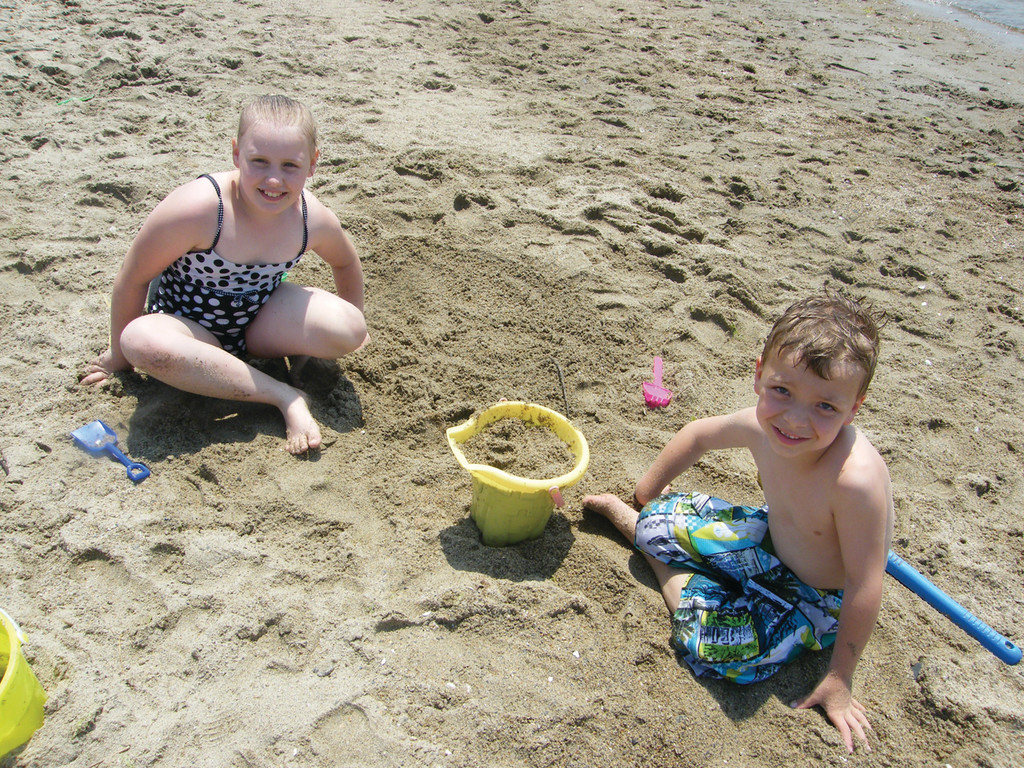 "X MARKS THE SPOT: Samantha Allen, 9, and Dominic Robbio, 6, said they were digging for ""buried treasure"" at Oakland Beach yesterday. Armed with scoops and buckets, Samantha said they managed to find some interesting rocks."