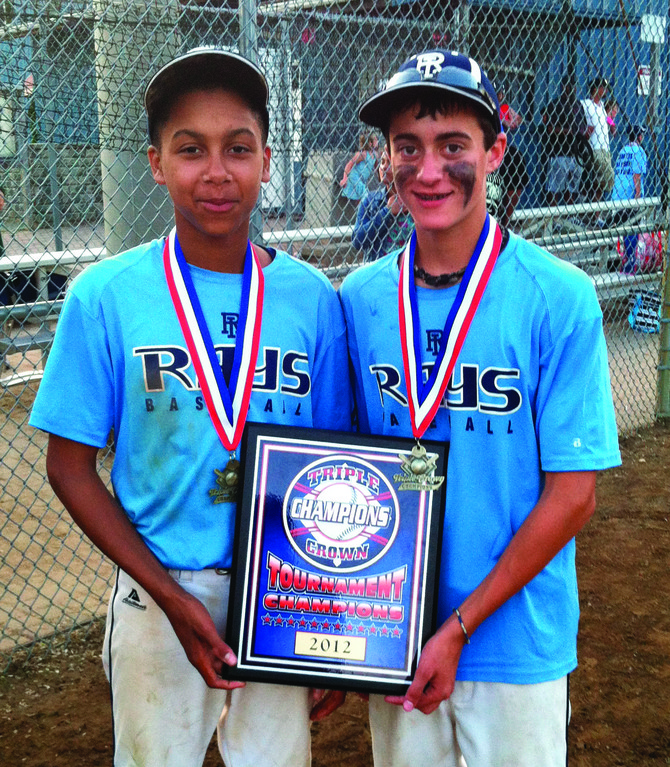 STRONG SEASON: R.I. Rays members and Warwick natives Elijah Brown and Andrew Almonte pose with a championship plaque.