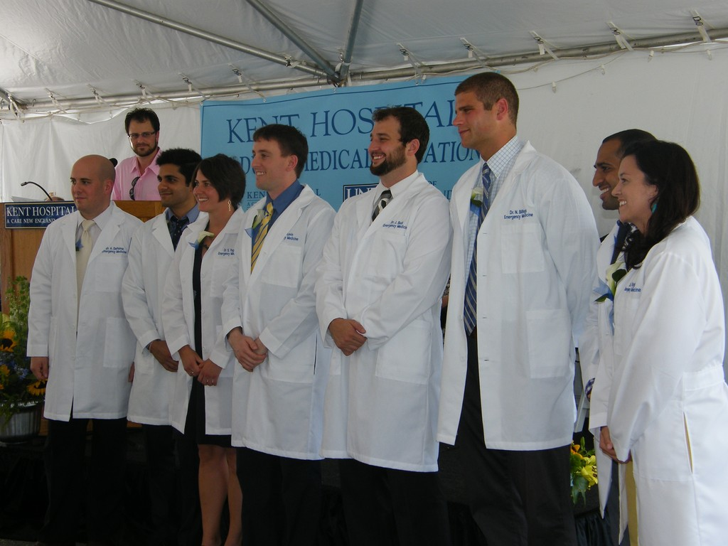 IN WITH THE NEW: Doctors entering the Kent Hospital residency program for Emergency Medicine donned white lab coats at the resident graduation ceremony held on-site Friday.