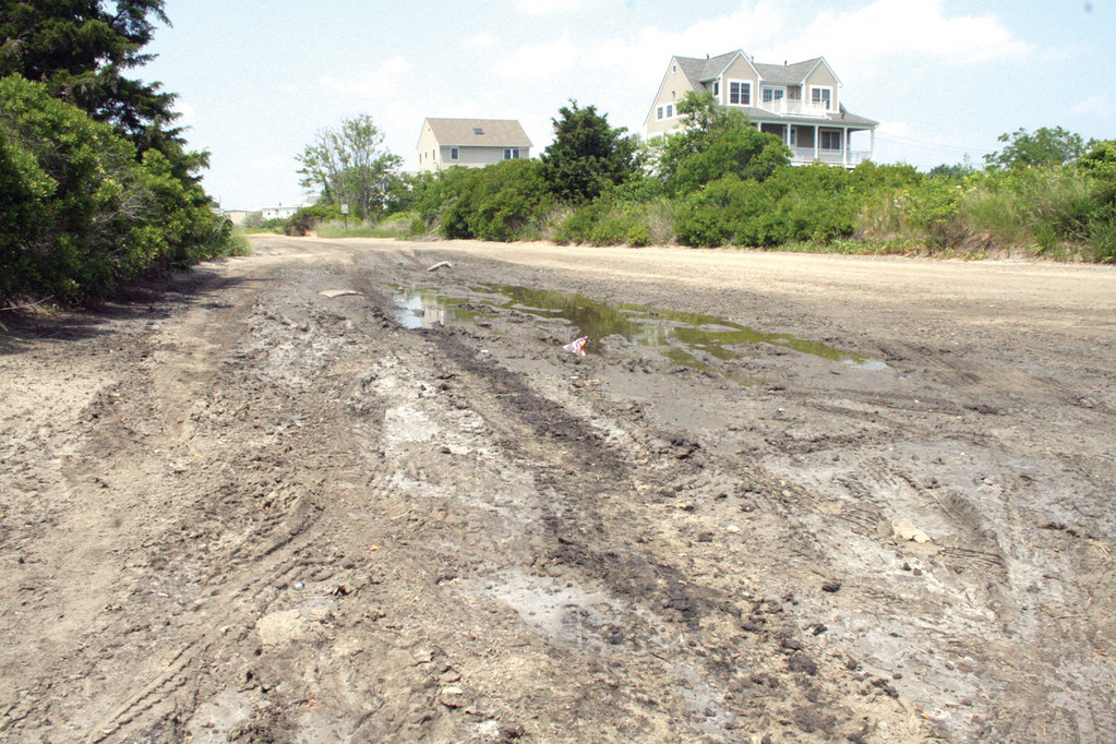 DODGE THE DIPS: Coldwell Street is one of several unpaved roads on Conimicut Point, of which most probably remain as they are because of environmental concerns and lack of funds to pave them.