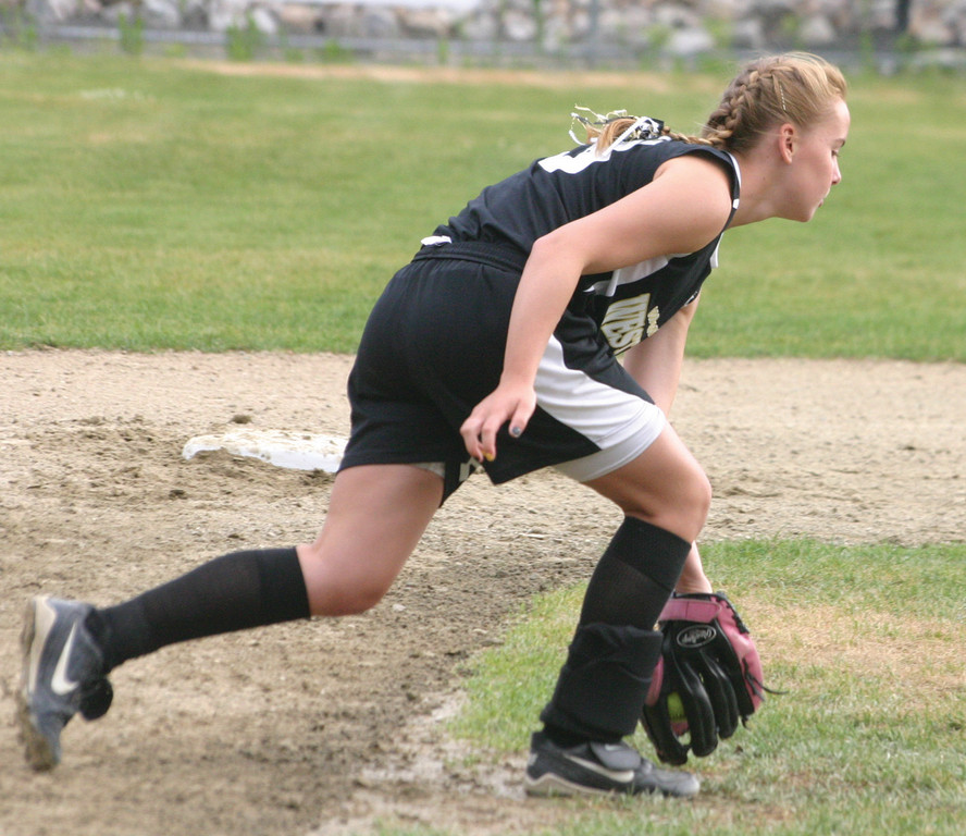 ON THE BALL: Jeriann Evans scoops up a ground ball at shortstop in the second inning.
