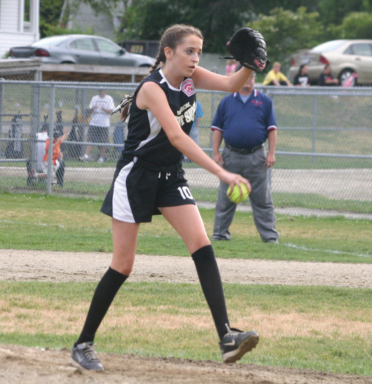 DEALING: West Side's Gabby Scalzo winds up for a pitch in Tuesday's winners' bracket game in the District 3 12-year-old softball tournament. West Side won for a spot in the finals.