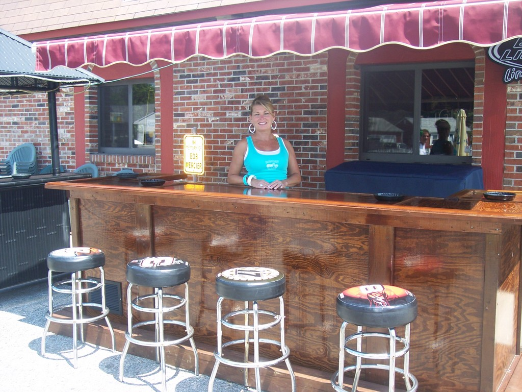Bartender Joanne serves up a cold draft beer at Moranto's outdoor bar and patio -open for business.
