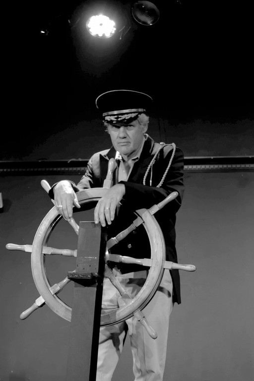 Charles Sweigart as the Captain.
