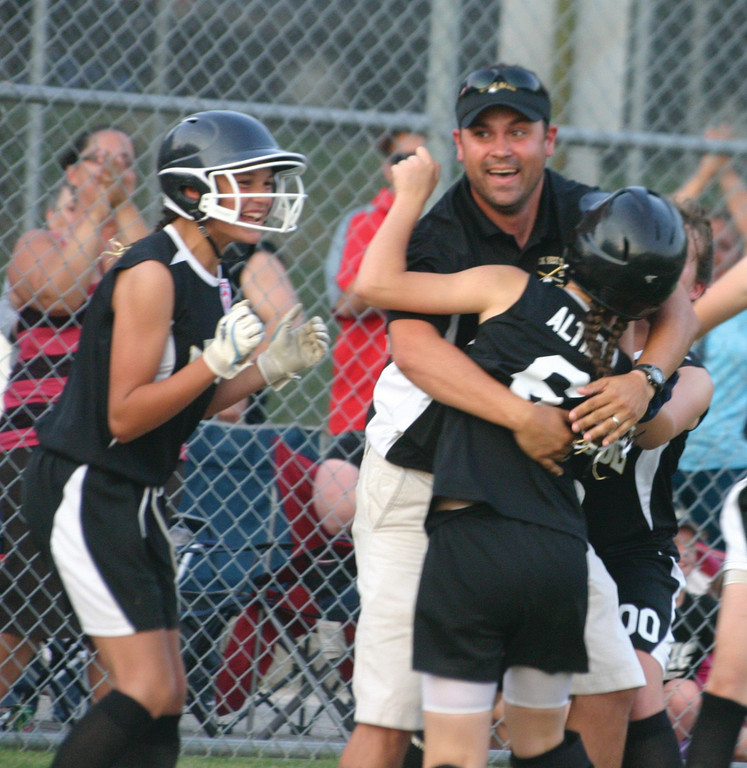 FOR THE WIN: West Side 12-year-old softball manager Billy King celebrates with Kristiana Altieri after she scored the winning run in Friday's district championship.