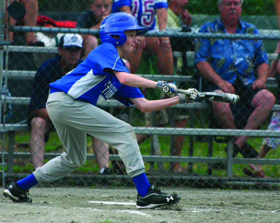 LOOKING IT IN: Ronnie Minear holds the bat out for a bunt attempt on Sunday.