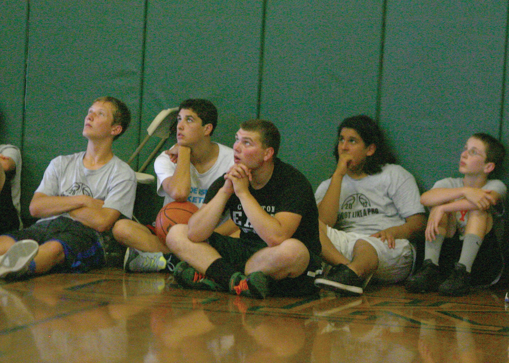 Some of the clinic's participants watch Billy Baron go through Rob McClanaghan's training session.