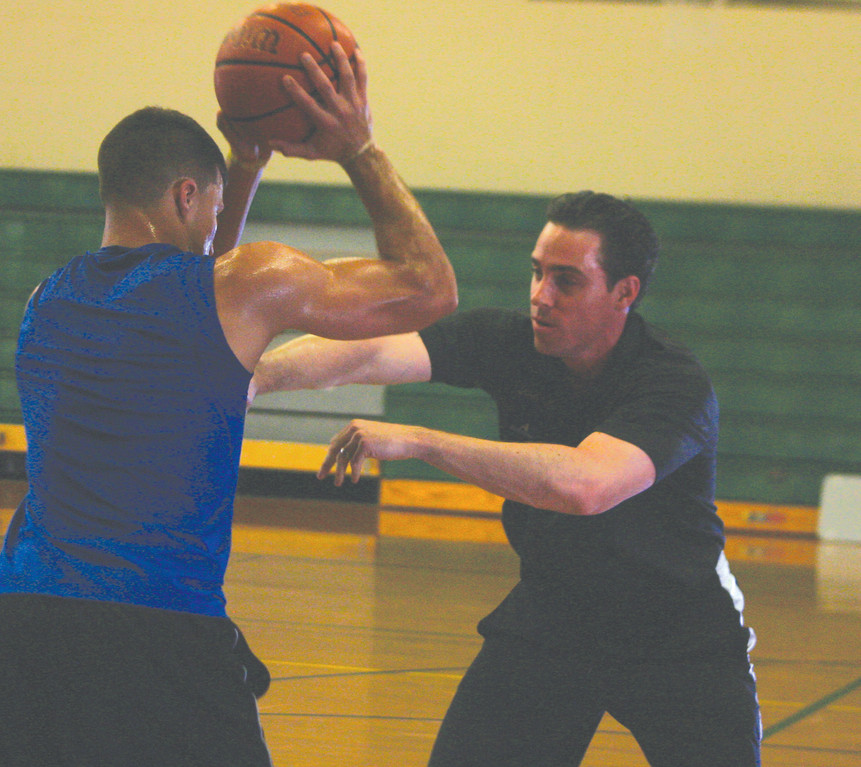 TRAINING: Rob McClanaghan worked out former Hendricken and current URI player Billy Baron on Saturday during the clinic.