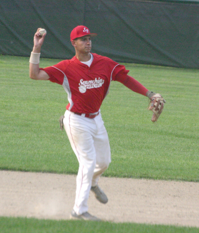 Third baseman Gian Maartellini makes a throw to first.