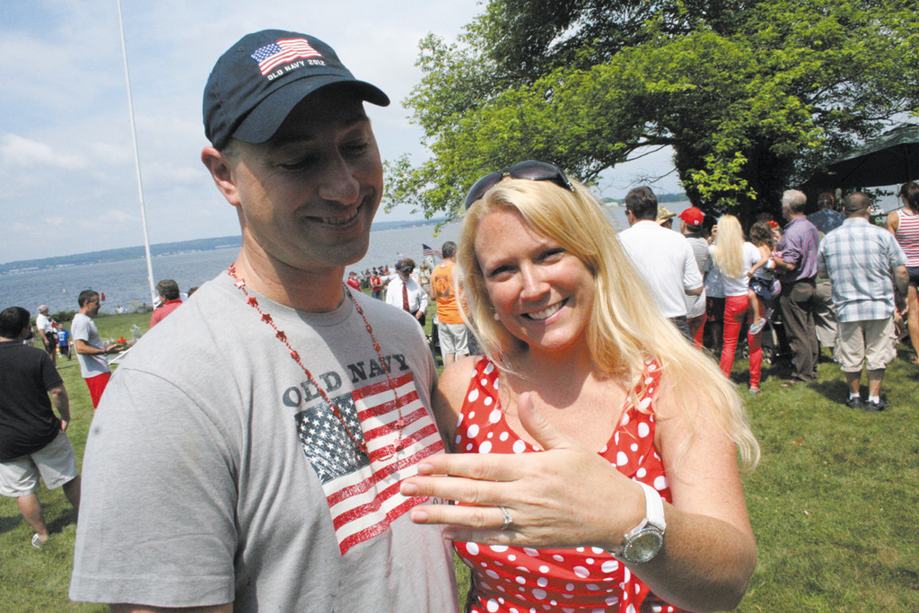 PARADE PROPOSAL: Seeing that Fourth of July has been her favorite day of the year, Steve Bentley of Coventry decided to ask his girlfriend of two years, Amy Flynn, to be his wife.