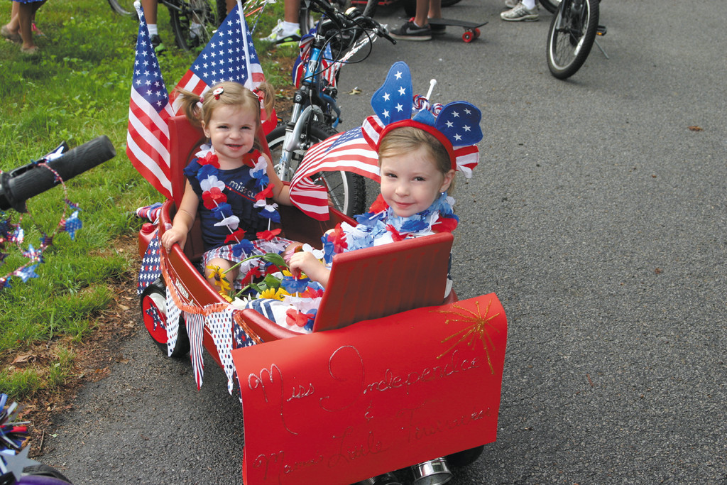 "LITTLE FIRECRACKERS: Sophie Matteson, 1, and her older sister Amelie, 3, were set to take part in the 20th annual Warwick Neck Parade, as ""Mama's Little Firecracker,"" and ""Miss Independence,"" respectfully."