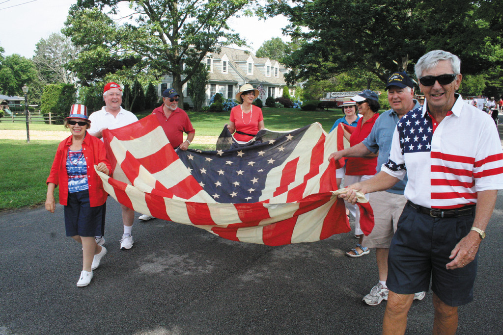 GRAND OLD FLAG: John Clegg and friends carry a 45-star flag that dates back to 1896.