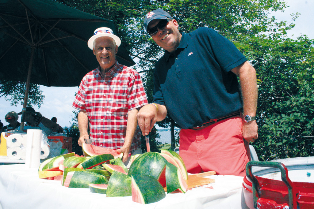 CUT UPS: Jack Henriques and Brad Peterson serve fresh watermelon.