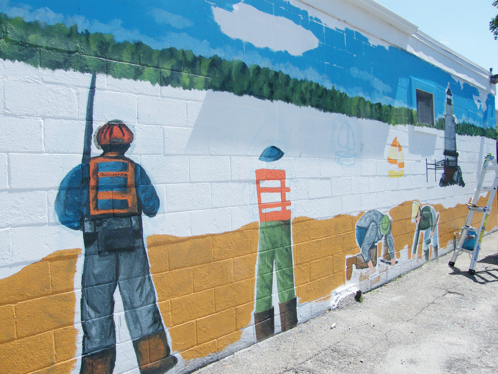 WORK OF ART: The nearly finished mural in Conimicut.