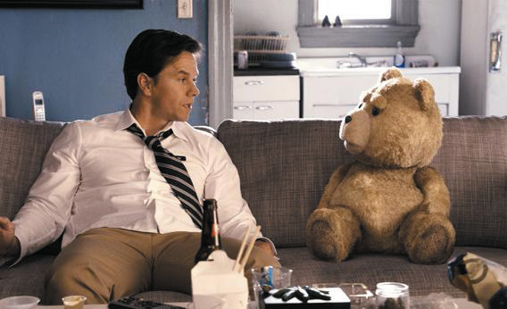 "John (Mark Wahlberg) hangs out with his best friend, Ted (voiced by Seth McFarlane), in ""Ted."""