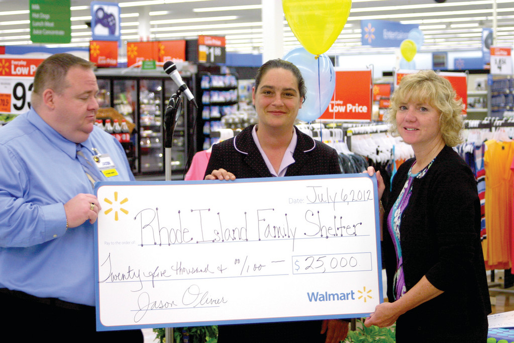 COMMUNITY SUPPORT: Patti Macreading (right) receives a donation from Post Road Wal-Mart Manager Jason Olivier (left) and Alexis Tulli.