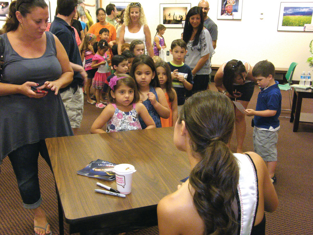 CAN I HAVE YOUR AUTOGRAPH? A line of youngsters (and their eager parents) wait to get Miss USA Olivia Culpo's autograph.