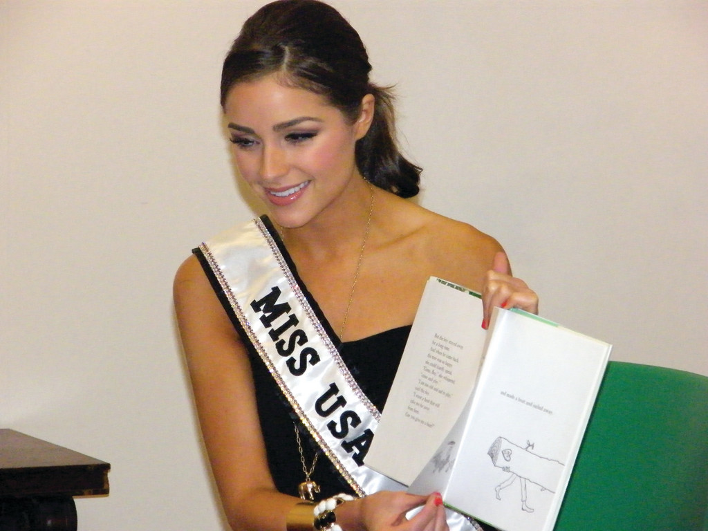 "GIVING TREE: Miss USA, Olivia Culpo, reads ""The Giving Tree"" at the Cranston Public Library on Friday."