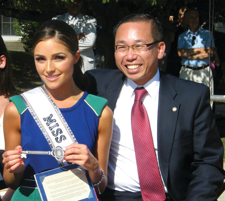 KEY TO THE CITY: Olivia Culpo shows off the handcrafted, pewter key to the city that Mayor Allan Fung presented to her.