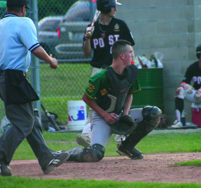 OUT IN FRONT: NEFL catcher Lee Verrier catches a throw from the outfield Sunday night.