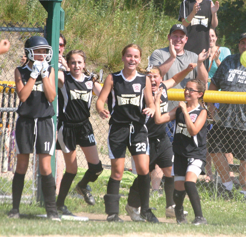 AGAIN: West Side's 12-year-old softball all stars celebrate after Sunday's comeback win in the state tournament. West Side has trailed in the sixth inning in three of its four games this summer.