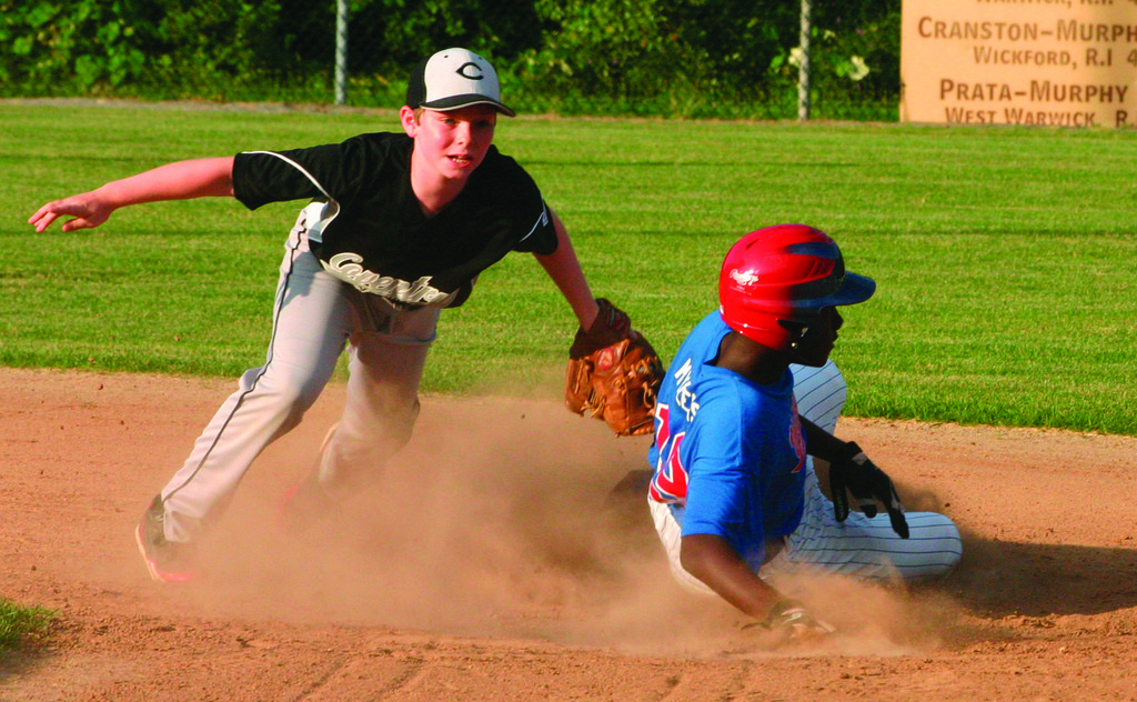CAUGHT: Continental's Isaiah Mylers tries to get around the tag of Coventry National shortstop Colin Sutyla on a stolen base attempt during Thursday's game.