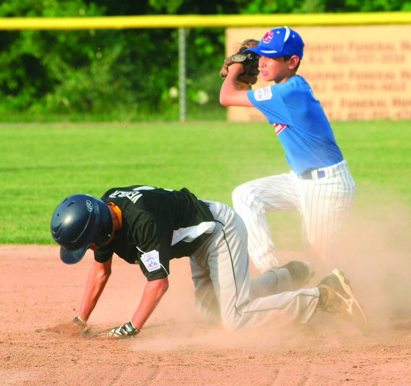 PLAY AT SECOND: Jeff Venter shows the ball after tagging Coventry National's Steven Verrier.