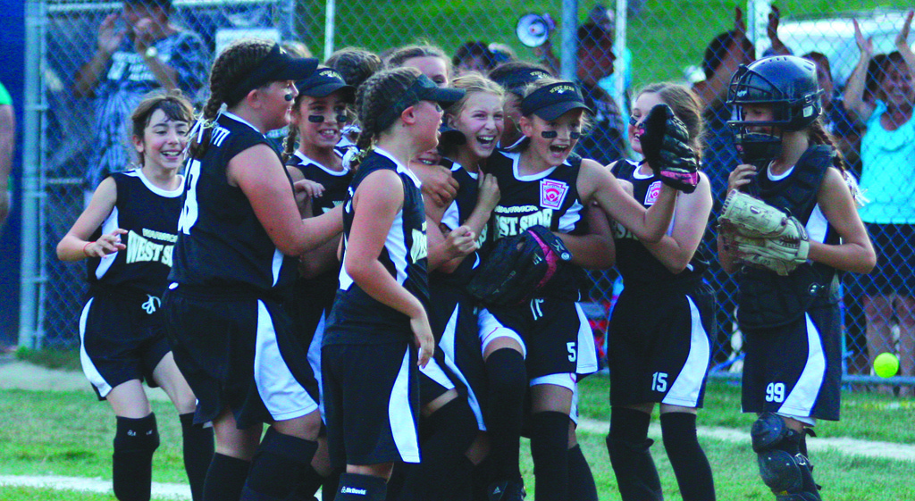 CHAMPS: The Warwick West Side 9/10-year-old all stars celebrate Sunday's 15-5 victory over Westerly National in the District 3 championship. West Side has won two consecutive 9/10 championships.