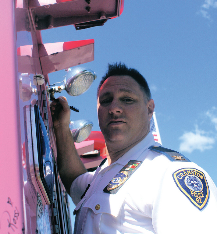 FROM THE TOP: Cranston Police Chief Col. Marco Palombo was among the first signers of the pink fire truck brought to the blood/bone marrow drive for Miranda Petrella last week.
