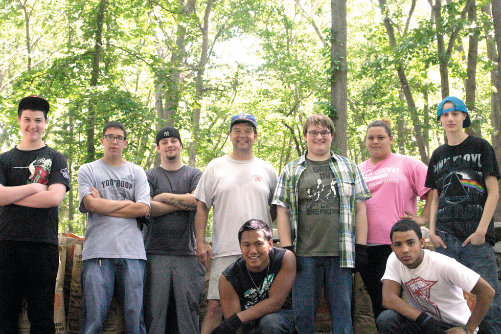 "DIRTY AND SWEATY BUT SMILING: The Learn to Earn youths take a short break from raking. Pictured left to right, back row: Brenden Allen, Ray ""McLovin"" Fleming, Jake Nappa, Gary Littlefield of CCAP, Scott Oliver, Amber Palazzo, and Ian Leary. Pictured left to right, front row: Bobby ""Tsunami"" Martorelli and Ivan Perez."