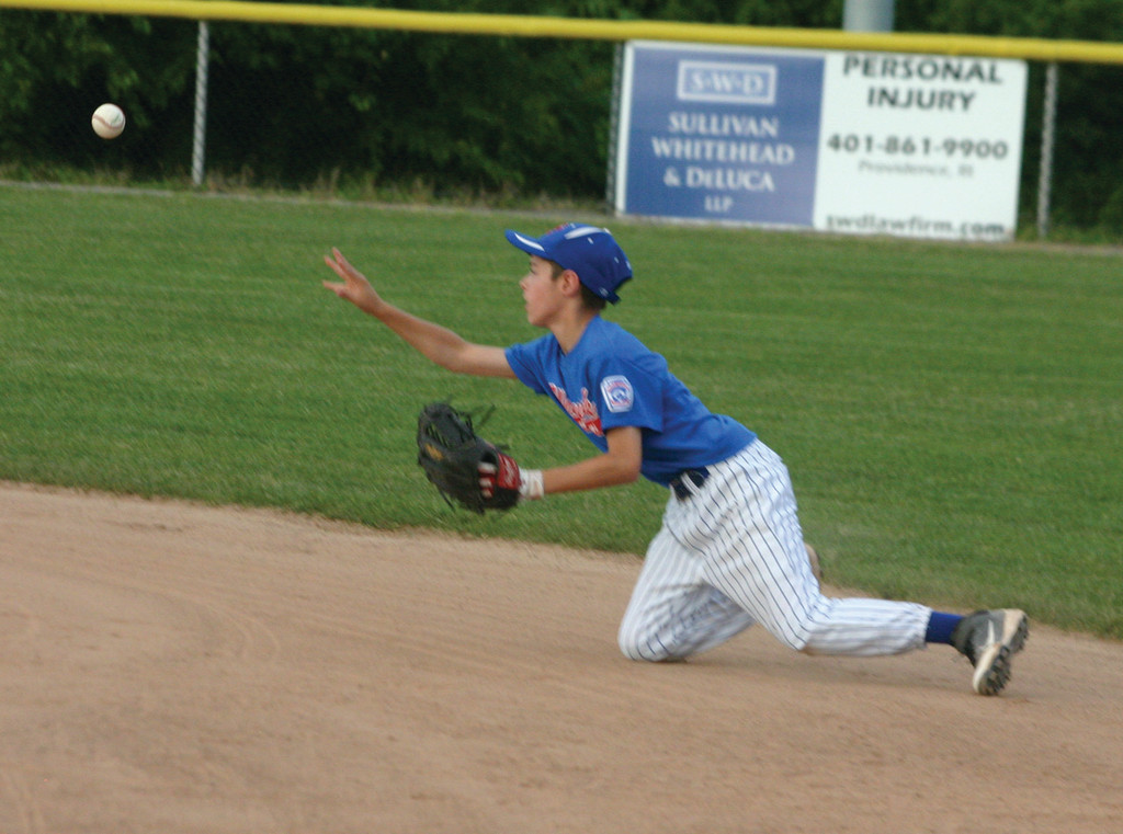 ON THE MOVE: Second baseman Matt Martinez flips a ball to the bag after fielding a grounder on Monday night.