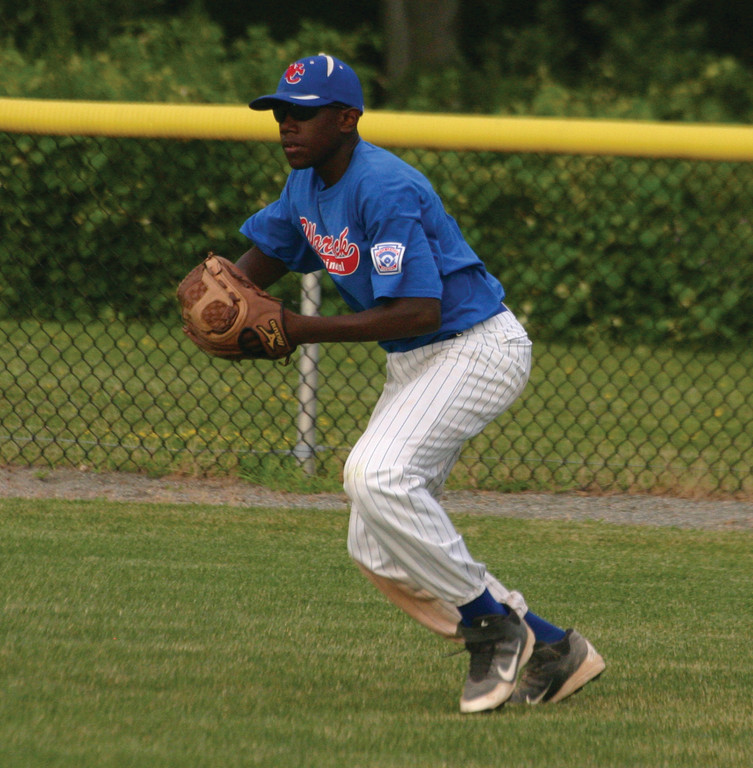Isaiah Mylers tries to get the ball quickly back to the infield.