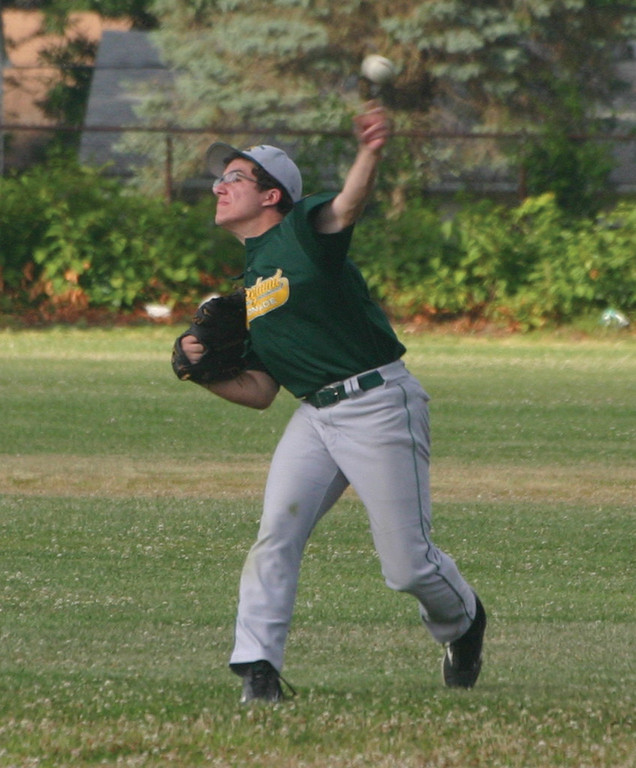 THROW IT: Brett Ferguson makes a throw in from the outfield last Thursday against Warwick PAL.