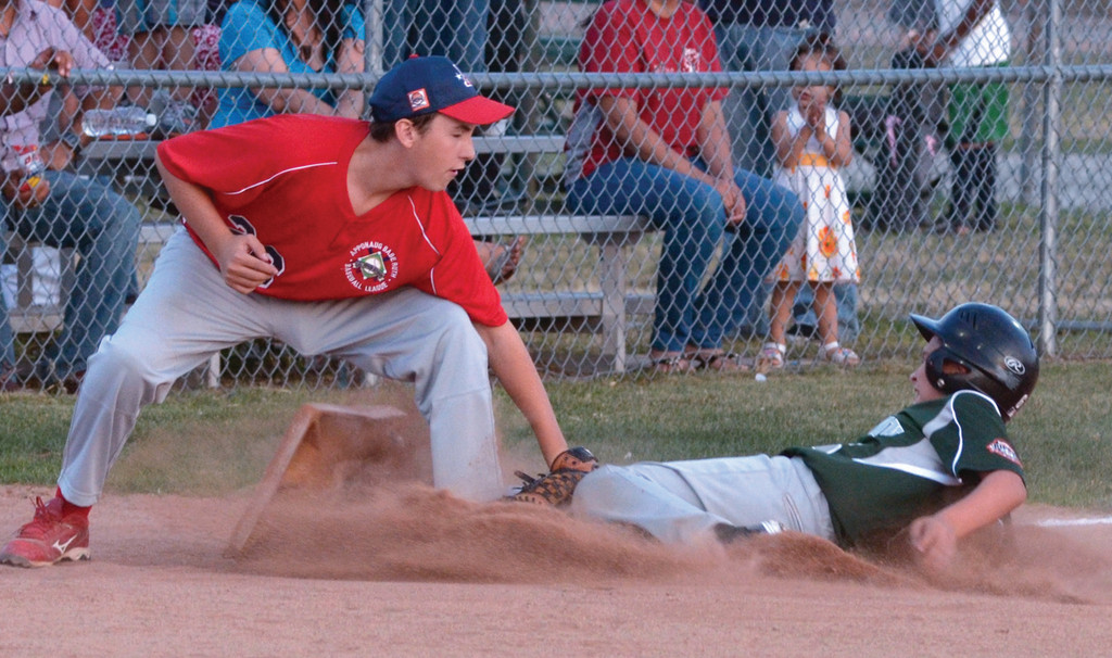T.J. Kyle tags out at CLCF's Derek DiLanna at third base.