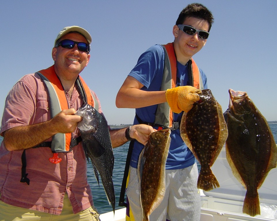 Patrick DeSorbo (left) and his son Kevin of Clifton Park, N.Y., enjoyed a day of charter fishing for fluke (summer flounder) and black sea bass this weekend off Newport.